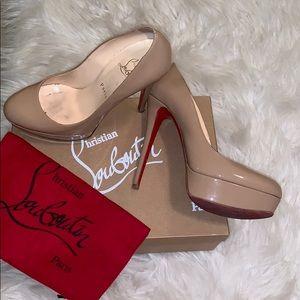 Christian Louboutin nude heels in bianca.
